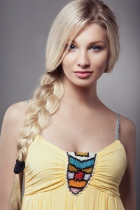 Blonde young woman with braid hairdo
